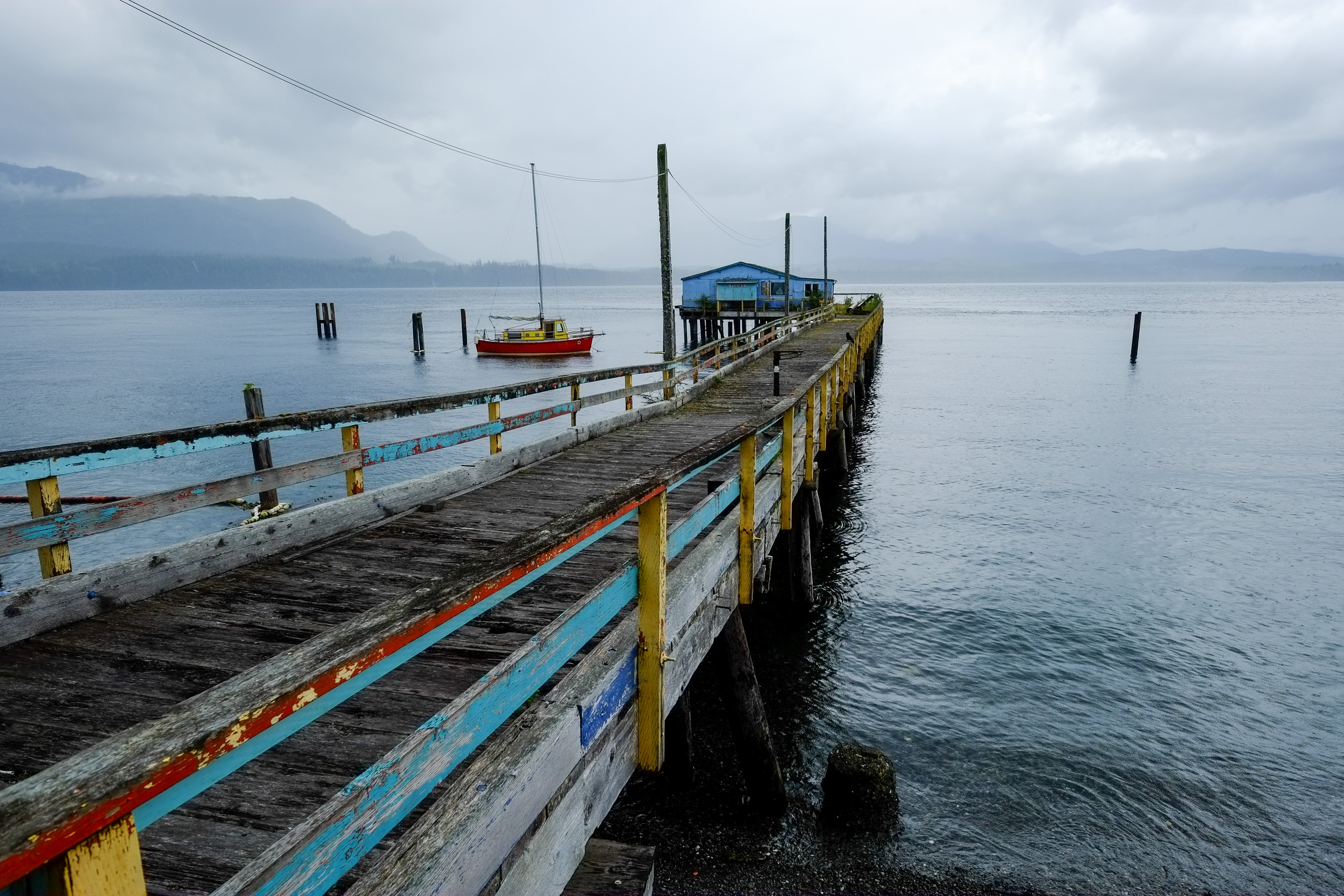 A commercial pier extends into Johnstone Strait in Alert Bay, BC.